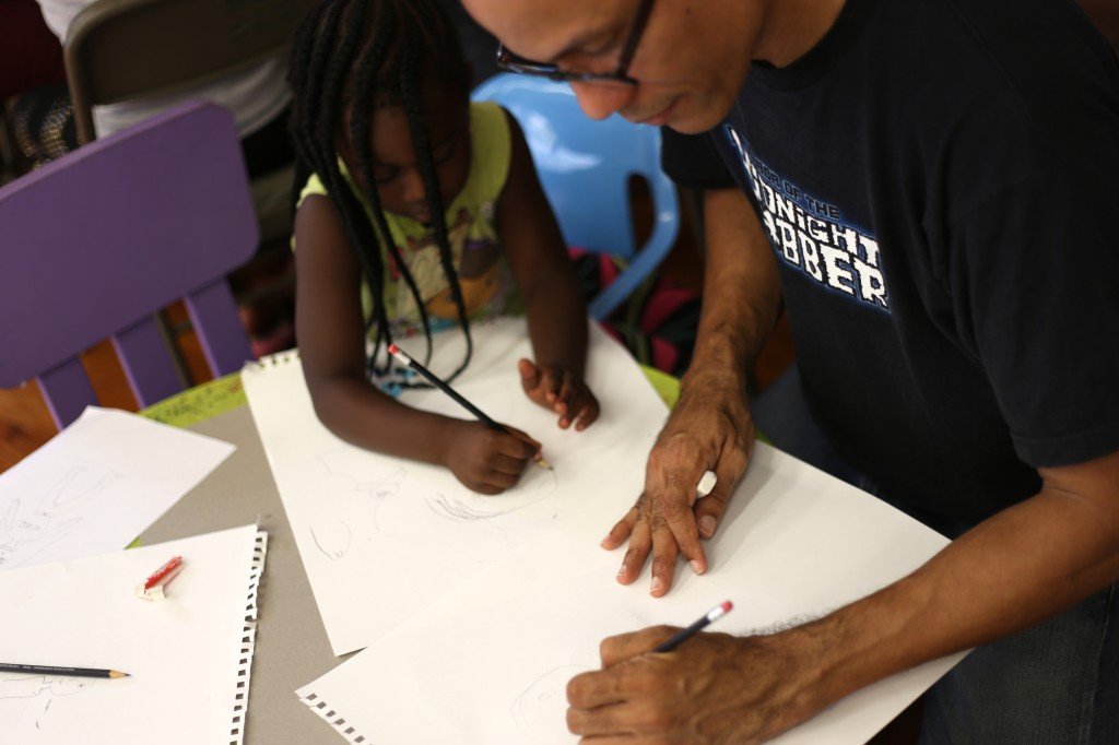 Chris Riley from Three Quarter Comics working with our heroes after his session showing them how to draw a superhero