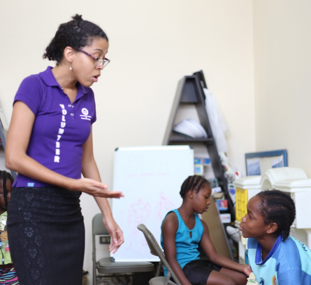 Giselle Mendez from The Volunteer Centre of Trinidad and Tobago with heroes on a session promoting social responsibility
