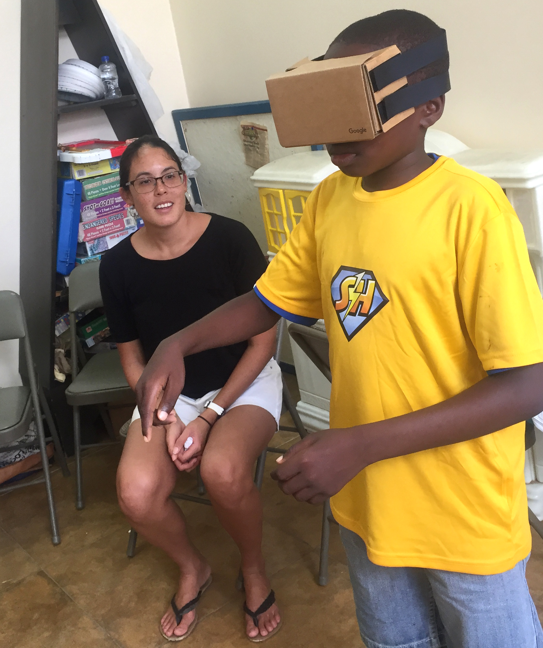 Marine Biologist Dr Anjani Ganase with her virtual reality goggles showing underwater coral reefs. This followed her session with the children and making edible corals.'