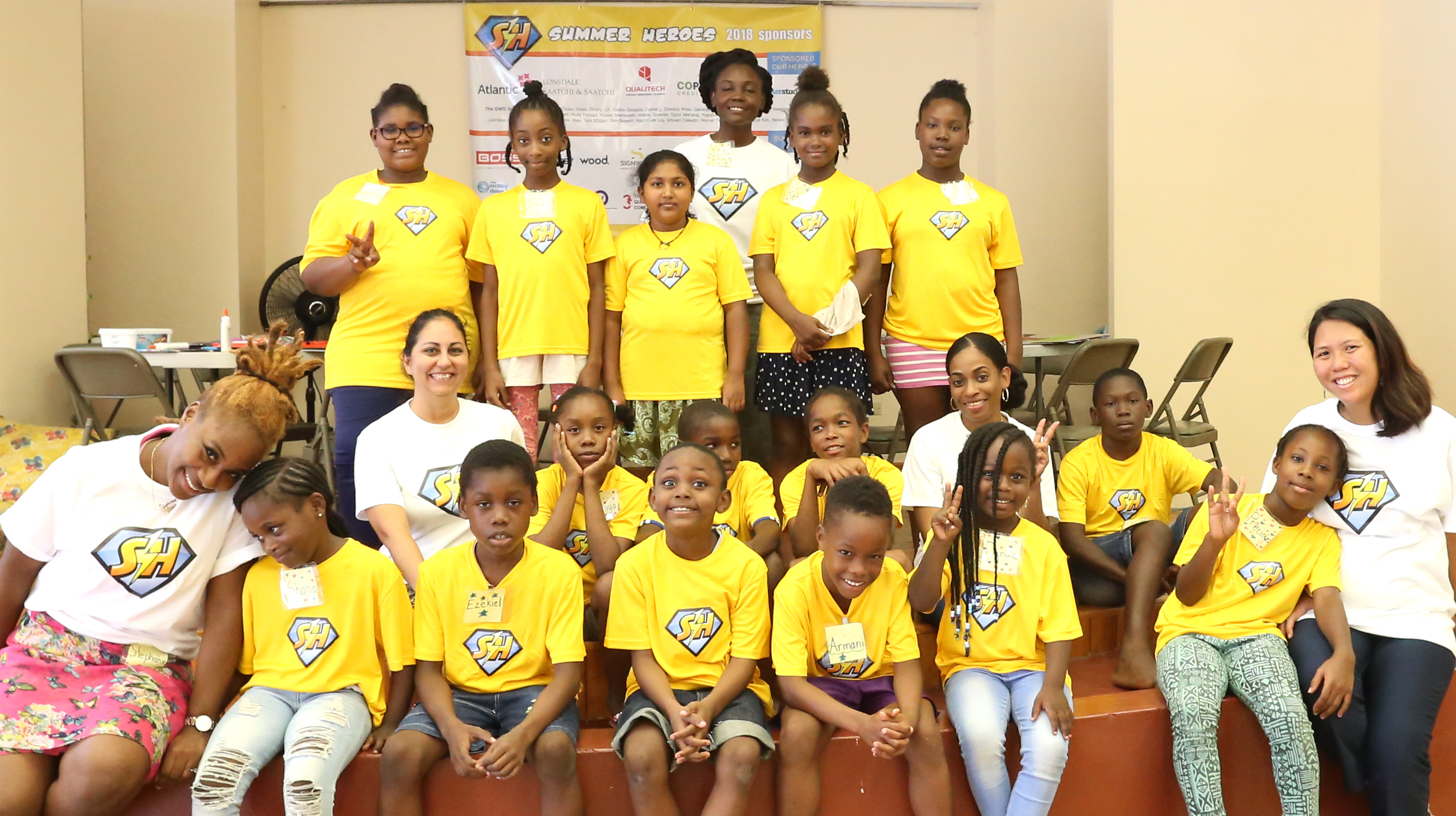Summer Heroes Camp Jaime Lee Loy to the far right and volunteers Back to Front left to right include Akilah Edwards Stephanie James Shana Bhajan Petra McLeod
